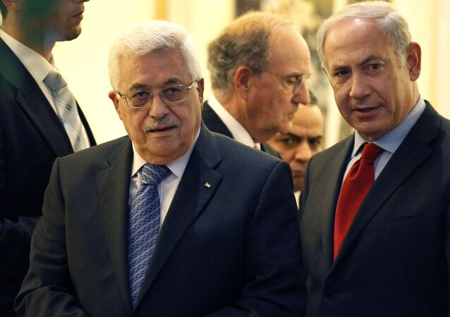 Palestinian president Mahmoud Abbas, left, walks with Israeli Prime Minister Benjamin Netanyahu, right, with Special Middle East Peace Envoy, former Sen. George Mitchell, behind center, at his residence in Jerusalem, Israel Wednesday, Sept. 15, 201
