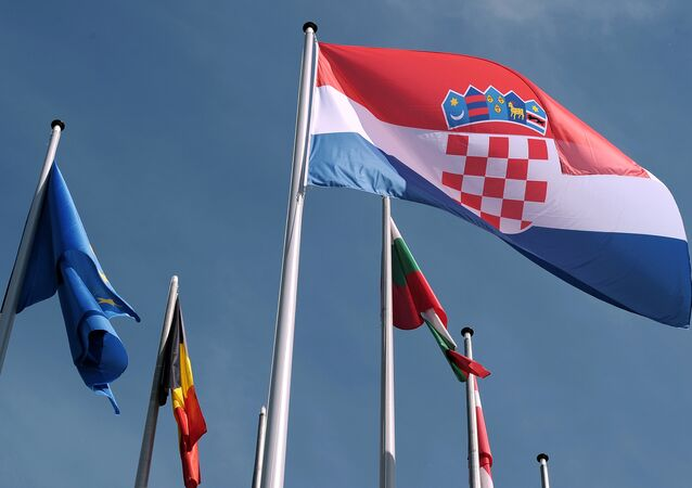 Croatian flag is raised during a ceremony for Croatia's accession to the European Union on July 01, 2013, in the European Parliament in Strasbourg, eastern France