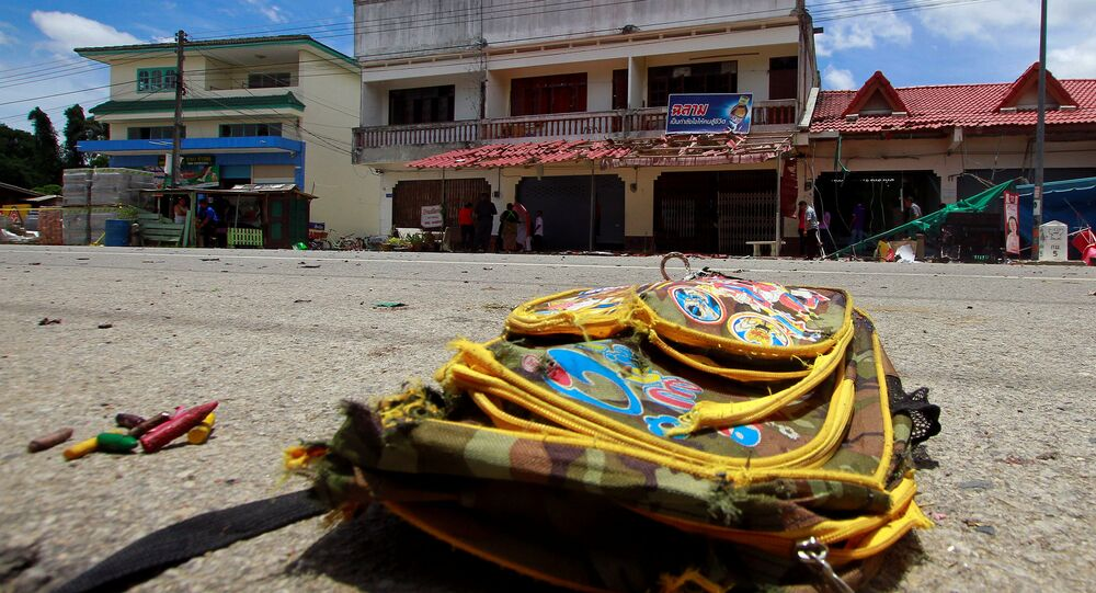 A school bag lies on a street next to the site of a bomb attack at Tak Bai district in the troubled southern province of Narathiwat, Thailand, September 6, 2016
