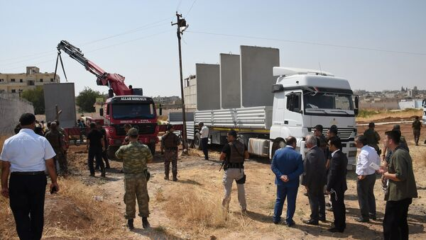 Civil and military authorities inspect the construction of a border wall between Turkey and Syria near the Mursitpinar border gate in Suruc, bordering with the northern Syrian town of Kobani, in southeastern Sanliurfa province, Turkey, August 29, 2016 - Sputnik International