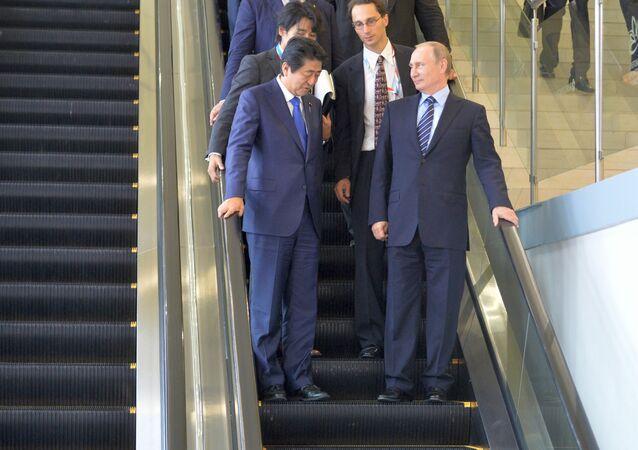 Russian President Vladimir Putin and Japanese Prime Minister Shinzo Abe meet at the Eastern Economic Forum on Russky Island, September 2016
