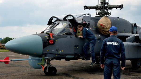 Mechanics work on a Ka-52K Katran helicopter at the Progress aviation plant in the Primorsky Territory - Sputnik International