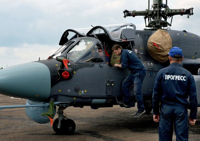Mechanics work on a Ka-52K Katran helicopter at the Progress aviation plant in the Primorsky Territory