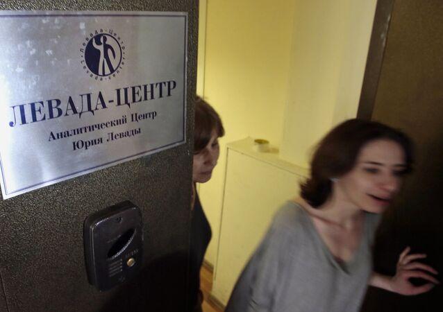 Levada Center employees leave their office with the sign  Levada-center. Jury Levada analytic center. in Moscow, Russia, Monday, May 20, 2013