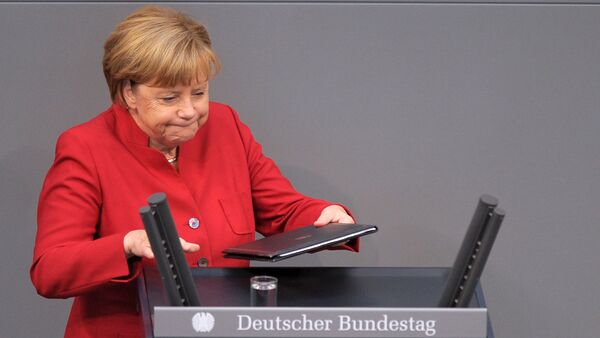 German Chancellor Angela Merkel walks to the desk during a meeting at the lower house of parliament Bundestag on 2017 budget in Berlin, Germany, September 7, 2016 - Sputnik International