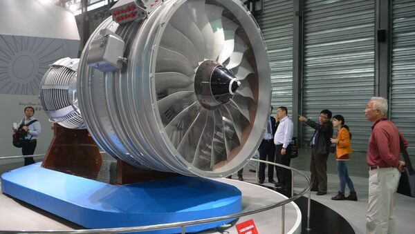 This file photo taken on November 7, 2013 shows visitors looking at a full-size model of an aircraft jet engine made by China Aviation Industry Corporation at the China International Industry Fair in Shanghai - Sputnik International