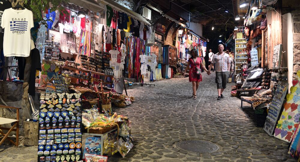 People walk at the old agora (market place) in the resort town of Mithymna (also referred to as Molyvos) on the island of Lesbos, affected by a drop in tourism due to the refugee crisis, on July 19, 2016