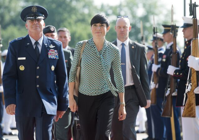 Norway's Defense Minister Ine Marie Eriksen Søreide walks past an honor guard as he arrives to attend a meeting of defense ministers of the Global Coalition to Counter ISIL at Joint Base Andrews in Maryland, July 20, 2016