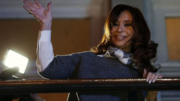 Argentina's former President Cristina Fernandez de Kirchner waves to her followers from the balcony of her offices after paying tribute to late Venezuelan president Hugo Chavez in Buenos Aires, Argentina, Thursday, July 28, 2016 - Sputnik International