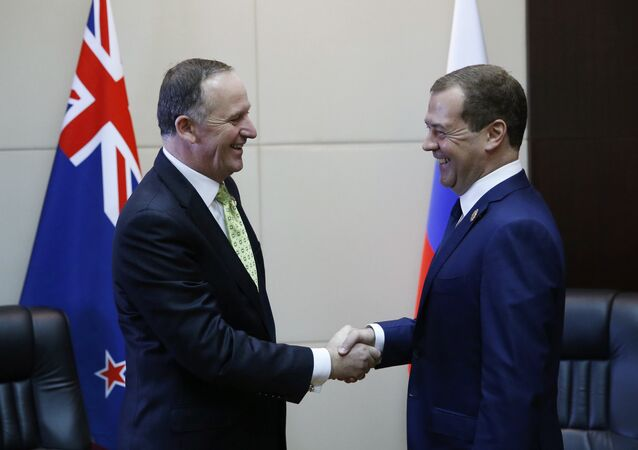 Russian Prime Minister Dmitry Medvedev (right) and Prime Minister of New Zealand John Key during a meeting in Vientiane