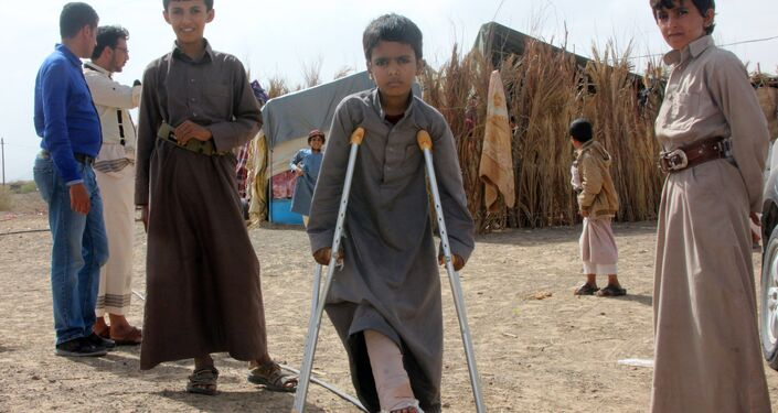Mabruk Mughrabi (C), a Yemeni boy injured in his leg as a result of a land mine, stands with friends at a camp for internally displaced on the outskirts of Marib on April 15, 2016