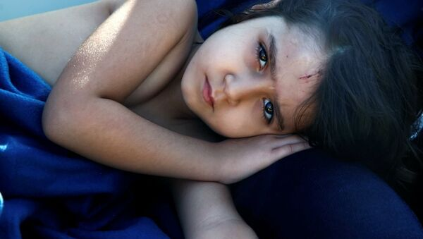Syrian refugee girl Housaida rests inside the Spanish rescue vessel Astral after being rescued by the Spanish NGO Proactiva off the Libyan coast in the Mediterranean Sea August 18, 2016. - Sputnik International