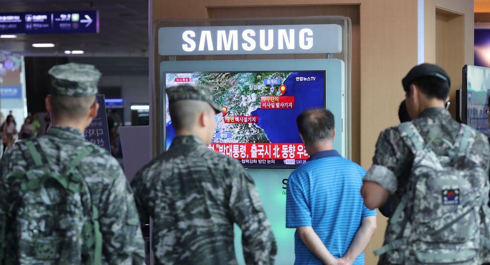 South Korean soldiers and passenger watch a TV broadcasting a news report on Seismic activity produced by a suspected North Korean nuclear test, at a railway station in Seoul, South Korea, September 9, 2016.