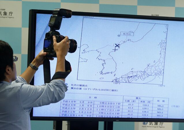 A photographers takes picture of a monitor showing the seismic event was indicated on North Korea and observed in Japan during a news conference at the Japan Meteorological Agency in Tokyo, Japan, September 9, 2016.
