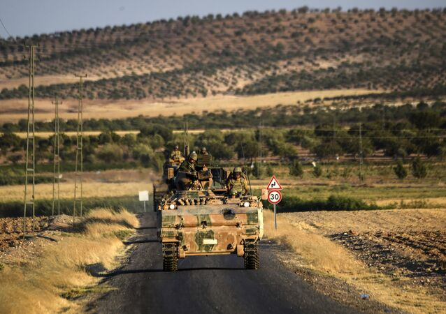 Turkish soldiers stand in a Turkish army tank driving back to Turkey from the Syrian-Turkish border town of Jarabulus on September in the Turkish-Syrian border town of Karkamis. (File)