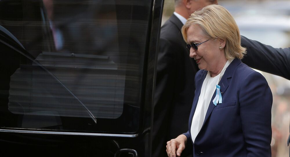 U.S. Democratic presidential candidate Hillary Clinton climbs into her van outside her daughter Chelsea's home in New York, New York, United States September 11, 2016, after Clinton left ceremonies commemorating the 15th anniversary of the September 11 attacks feeling overheated.