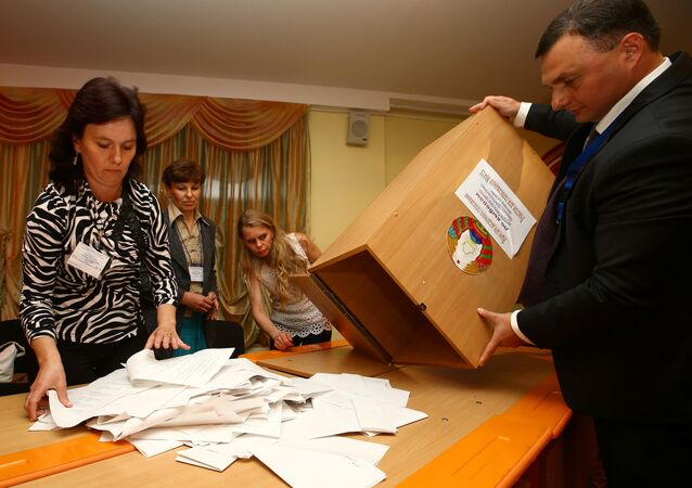Members of the local electoral commission empty a box to count ballots at a polling station after a parliamentary election in Minsk, Belarus September 11, 2016.