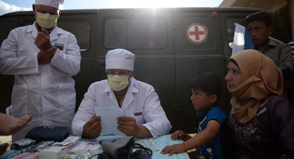 Russian doctors provide consultations to residents of Kaukab, Syria during the distribution of Russian humanitarian aid