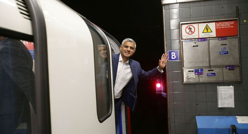 Mayor of London Sadiq Khan waves from the drivers carriage of a Victoria line tube train at Brixton Underground station during the launch of London's Night Tube, August 20, 2016.