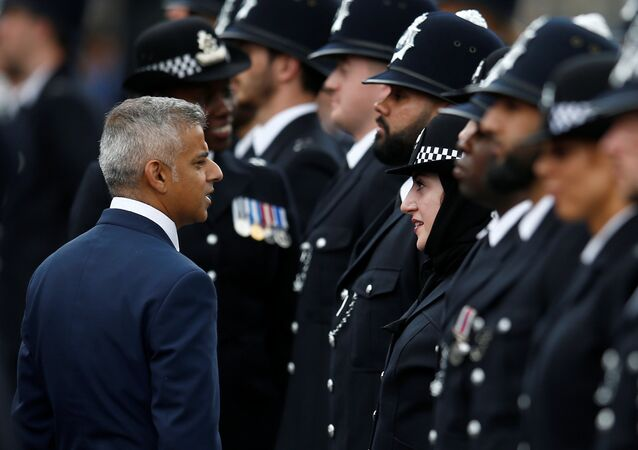 London Mayor, Sadiq Khan talks with new recruit, Mimi Adil at a passing-out parade at the new Peel Centre at the Metropolitan Police Academy in London, Britain September 9, 2016.