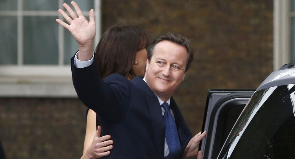 Britain's outgoing Prime Minister, David Cameron with his wife Samantha, waves in front of number 10 Downing Street, on his last day in office as Prime Minister, in central London, Britain July 13, 2016.