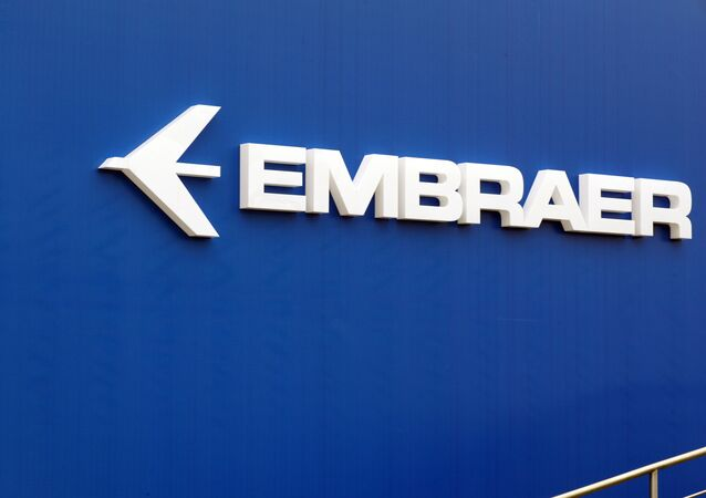 The logo of Brazil's aircraft manufacturer Embraer taken at Le Bourget airport, near Paris during the 50th International Paris Air show. (File)
