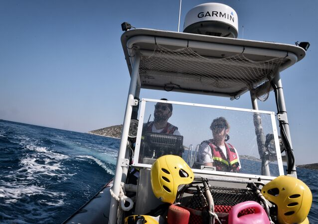 Hellenic Rescue Team members take part in a training exercise on a boat on the Greek island of Samos on September 1, 2016