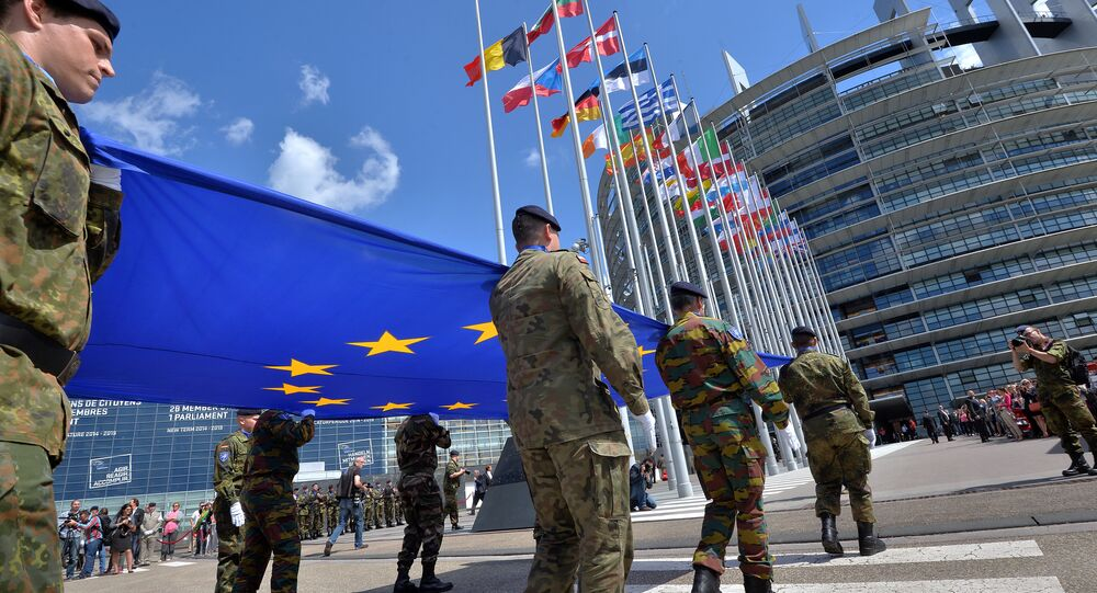 Soldiers of a Eurocorps detachment carry the European Union flag to mark the inaugural European Parliament session on June 30, 2014, in front of the European Parliament in Strasbourg, eastern France