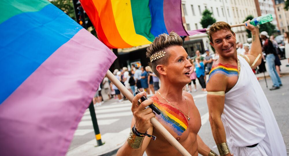 Participants carry a rainbow flag during the Gay Pride Parade on August 2, 2014, in Stockholm