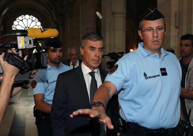 Former French budget minister Jerome Cahuzac (C) who resigned in 2013 after he admitted to have a Swiss bank account, arrives at the courtroom on the first day of his trial for tax fraud in Paris, September 5, 2016