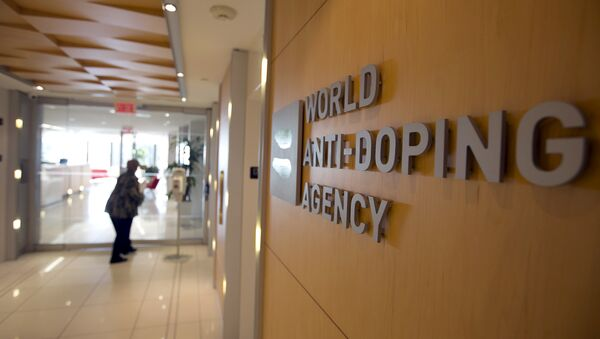 A woman walks into the head office of the World Anti-Doping Agency (WADA) in Montreal, Quebec, Canada November 9, 2015 - Sputnik International