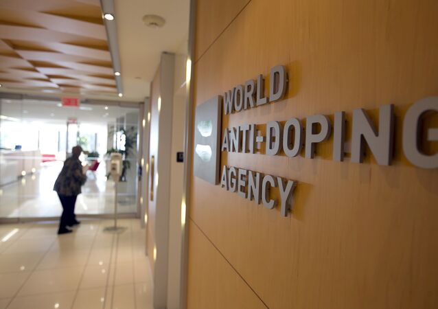 A woman walks into the head office of the World Anti-Doping Agency (WADA).