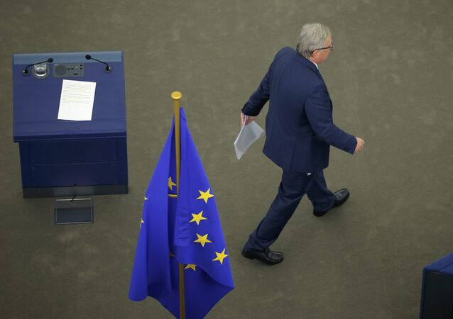 European Commission President Jean-Claude Juncker leaves the desk after his address to the European Parliament during a debate on The State of the European Union in Strasbourg, France, September 14, 2016