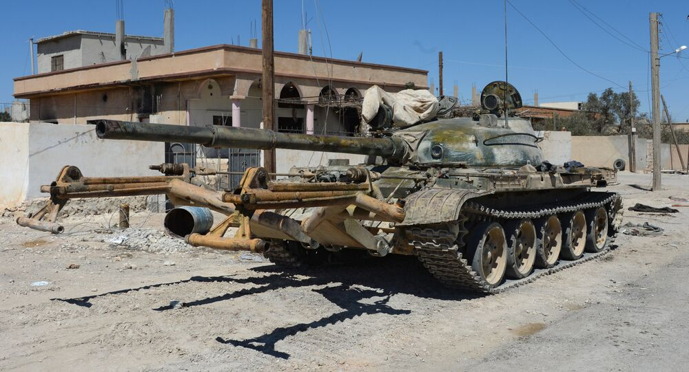 A T-55 tank in the position of the National Socialist Party's militia outside terrorist-held town of Al-Karyatein, Syria