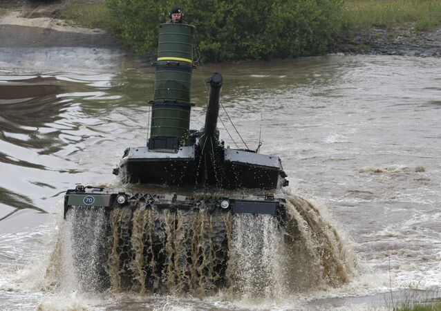 A main battle tank 'Leopard 2 A6' is going out a pond during an exercise of the German army on the training area in Munster, Germany, Monday, June 15, 2009