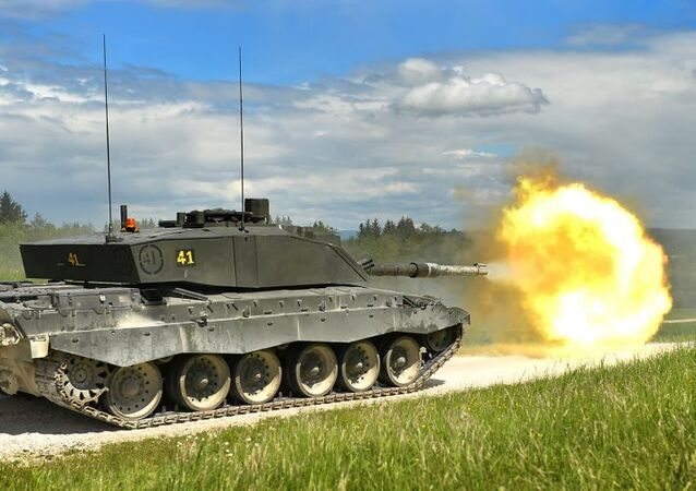 A Challenger 2 main battle tank (MBT) is pictured during a live firing exercise in Grafenwöhr, Germany