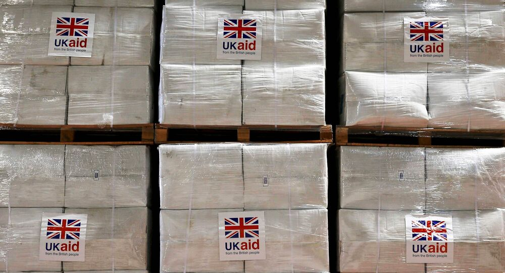 Boxes containing kitchen sets are stored at a UK Aid Disaster Response Centre where humanitarian supplies are being collected to be airlifted to Iraq at Cotswold Airport near the village of Kemble, Gloucestershire, southern England on August 14, 2014.