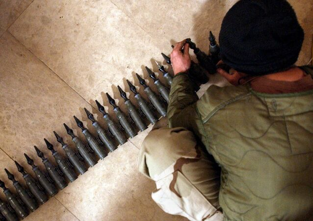 US Army Spcl. Eli Butcher of Charlie Company, from the 1-22 Battalion, 4th Infantry Division, counts 25mm rounds of depleted uranium ammunition, 11 February, 2004, at his base in Tikrit, 180 km (110 miles) north of Baghdad