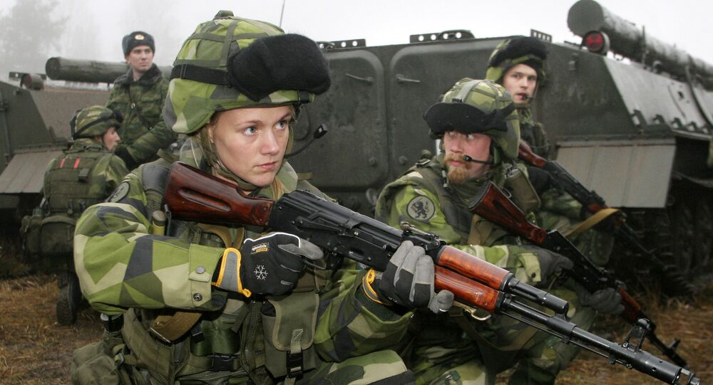 A female Swedish soldier participates in joint Russian-Swedish military training exercises, 12 December 2007, outside St. Petersburg in the town of Kamenka.