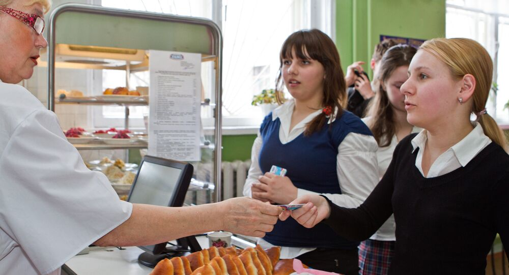 Russian students paying for high school canteen meals with electronic school cards. file photo