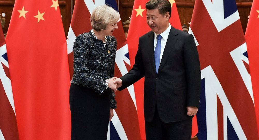 Chinese President Xi Jinping (R) shakes hand with British Prime Minister Theresa May before their meeting at the West Lake State House on the sidelines of the G20 Summit, in Hangzhou, Zhejiang province. File photo