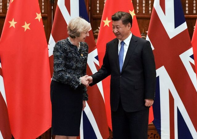 Chinese President Xi Jinping (R) shakes hand with British Prime Minister Theresa May before their meeting at the West Lake State House on the sidelines of the G20 Summit, in Hangzhou, Zhejiang province, China, September 5, 2016.