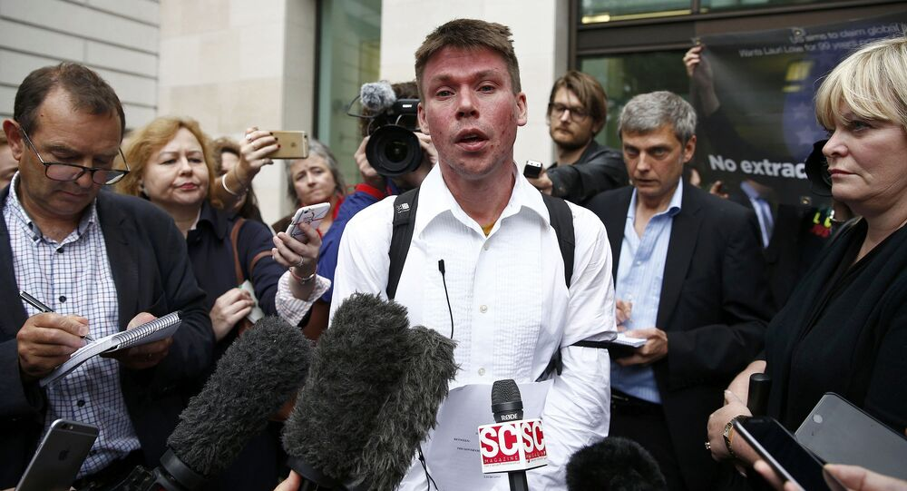 Lauri Love speaks to members of the media as he leaves after attending his extradition hearing at Westminster Magistrates' Court in London, Britain September 16, 2016.