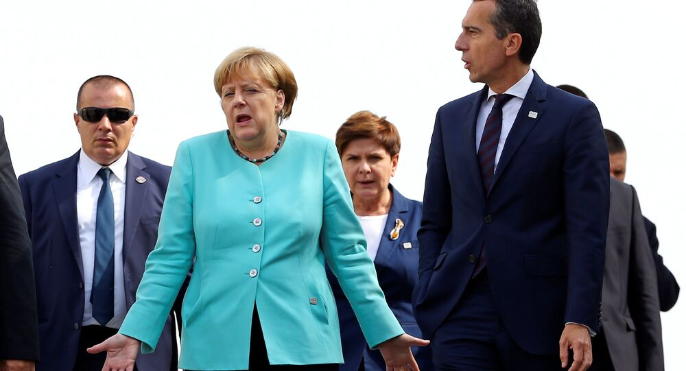 Germany's Chancellor Angela Merkel (L) and Austria's Chancellor Christian Kern arrive to pose for a family photo during the European Union summit - the first one since Britain voted to quit - in Bratislava, Slovakia, September 16, 2016.