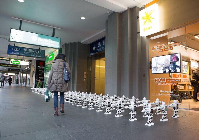 Dancing Robots Queue For New iPhone