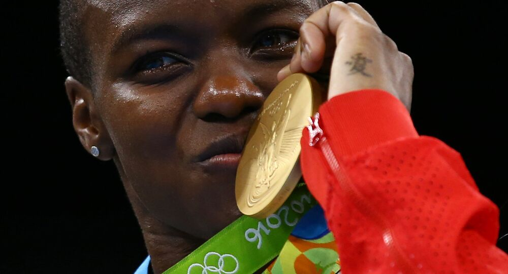 Gold medallist Nicola Adams (GBR) of Britain poses with her medal.