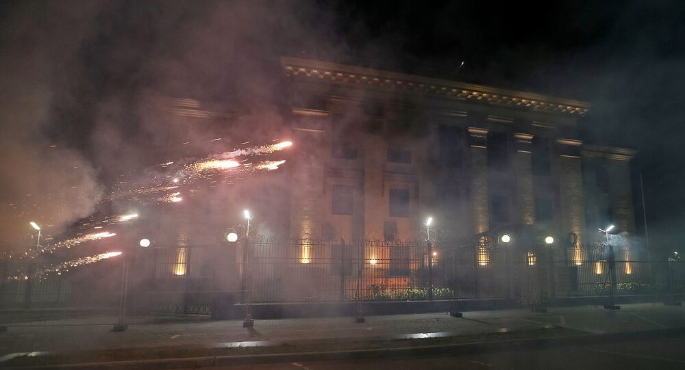 Fireworks launched by protesters, explode near the Russian embassy in Kiev, Ukraine, September 17, 2016.