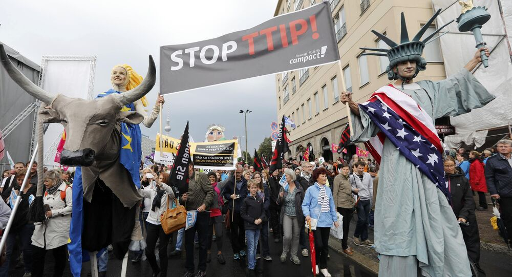 Consumer rights activists take part in a march to protest against the Transatlantic Trade and Investment Partnership (TTIP) and Comprehensive Economic and Trade Agreement (CETA) in Berlin, Germany