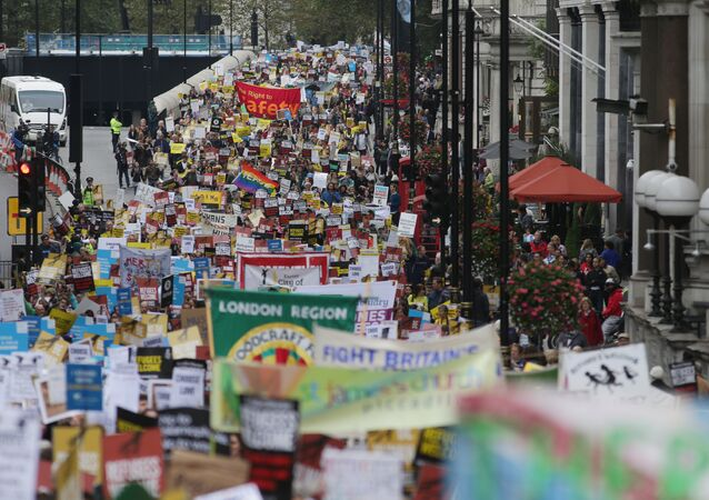 Demonstrators take part in a march calling for the British parliament to welcome refugees in the UK in central London