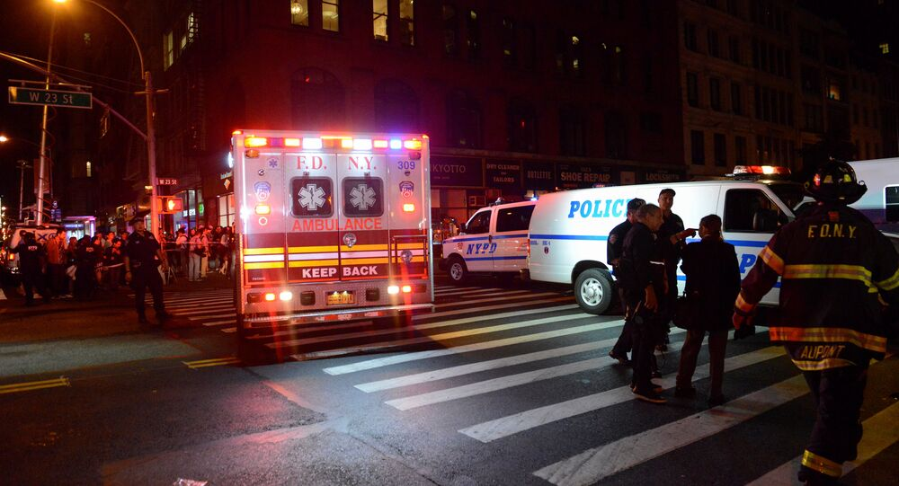 New York City police and firefighters stand near the site of an explosion in the Chelsea neighborhood of Manhattan, New York, U.S. September 17, 2016.
